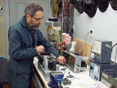 Bill Thurmeier working on a pair of vintage 40-watt vacuum tube power amplifiers in our shop